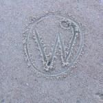 WordPress Logo in Sand